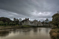 The desmond castle adare running of in from main road bridge Royalty Free Stock Photography