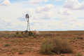 Desolate desert landscape a with old windmill and rusted barrel in arizona Royalty Free Stock Photography