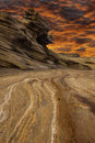 Desolate dry landscape with dramatic fiery skies Stock Photos