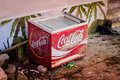 Desolated coca cola cooler a next to a season cafe that works only on spring and summer seasons in cinarcik town of turkey Royalty Free Stock Images