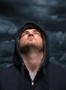 Despair bandit looking to dark sky Royalty Free Stock Photo
