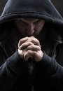 Despair bandit praying god for forgiveness Royalty Free Stock Photography