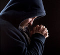 Despair bandit praying god forgiveness Royalty Free Stock Photos