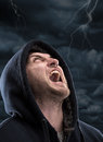 Despair bandit screaming to dark sky Stock Image
