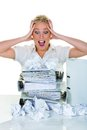 Despair by bureaucracy a young woman desperately in office between many file folders and crumpled papier symbolfoto for stress Royalty Free Stock Photography
