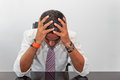 Desperate businessman portrait of a with his hands to his head as a concept of failure in business Stock Photography