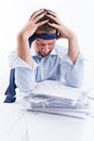 Desperate businessman portrait of sitting at office desk full with papers Royalty Free Stock Images