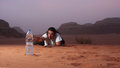Desperate man in the desert longing for water Royalty Free Stock Photo