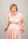 Desperate pregnant lady person in pink dress on gray background Royalty Free Stock Images