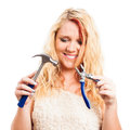 Desperate woman holding tools Stock Photo