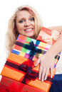 Desperate woman with many gifts holding colorful gift boxes isolated on white background Royalty Free Stock Photo