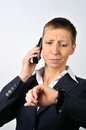 Desperate woman with a phone blonde businesswoman is calling Stock Photography