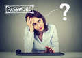 Desperate woman trying to log into her computer forgot password Royalty Free Stock Photo