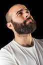 Desperation a masculine bearded man isolated over a black background Stock Images