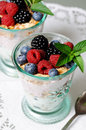Dessert with berries two glasses yogurt cereals and close up Royalty Free Stock Photo