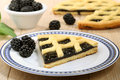 Dessert blackberry pie on ceramic plate Royalty Free Stock Photo