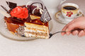 Dessert cake delicious in hand on the table Royalty Free Stock Image