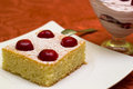 Dessert with cherries excellent sponge cream and Royalty Free Stock Images