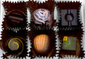 Dessert chocolates a collection of exquisite hand painted for the cacao connoisseur Stock Photo