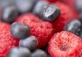 Dessert fresh berries close up the texture of raspberries and blue macro shot Stock Photos