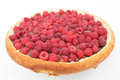 Dessert fruit tart covered in raspberries Royalty Free Stock Images