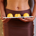 Dessert in hand at level of the abdomen temptation concept Stock Images