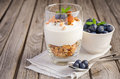 Dessert with homemade granola, yogurt and blueberries on rustic background Royalty Free Stock Photo