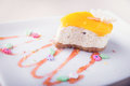 Dessert - Orange Cheesecake With Cute Decoration on White Backgr Royalty Free Stock Photo