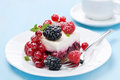 Dessert a piece of cake with fresh berries on blue background horizontal Stock Photos