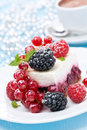 Dessert a piece of cake with fresh berries and coffee vertical Royalty Free Stock Image