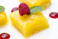 Dessert of pineapple and decorated with raspberries on a white background Stock Image