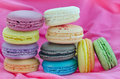 Dessert on pink fabric close up colorful french macaroons stack Stock Photography