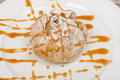 Dessert poached pear filled with pecans blue cheese and caramel sauce Royalty Free Stock Images