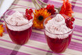 Dessert red in a glass red current jelly with a whipped cream on the top Royalty Free Stock Image
