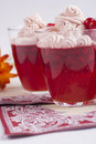 Dessert red in a glass red current jelly with a whipped cream on the top Stock Photography