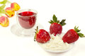 Dessert strawberries whipped cream red tea sudanese rose Stock Photography