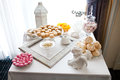 Dessert table white with different cakes Stock Image