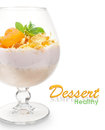 Dessert with yogurt muesli and dried apricots over white Royalty Free Stock Photography