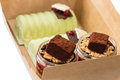 Desserts in cardboard box closeup of Stock Photo