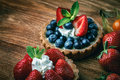 Desserts on wooden table sweet with strawberry and blueberry Royalty Free Stock Photo