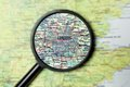Destination london close up of under a magnifying glass on a map Stock Photography