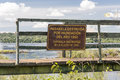 Destroyed catwalk iguassu argentina a sign on the ruins of the of park river in Stock Images