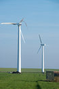 Destroyed and running wind turbine Royalty Free Stock Photo