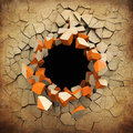 Destruction of a old grunge wall black hole in the cracked Stock Image