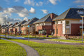 Detached family houses in a suburban street Royalty Free Stock Photo