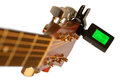 Detail of acoustic guitar with guitar clip tuner Royalty Free Stock Photo