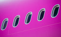 Detail of airplane windwos on pink Stock Image