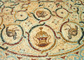 Detail of an ancient colorful mosaic fragment floor small tiles images the animals and birds floral ornament antique synagogue Royalty Free Stock Images