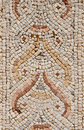 Detail of an ancient colorful mosaic fragment floor small tiles unusual geometric image oval forms in ornament synagogue israel Royalty Free Stock Photography