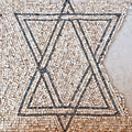 Detail of an ancient colorful mosaic fragment floor small tiles unusual geometric ornament antique jewish symbol star david israel Stock Photos
